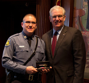 Gov. Jay Nixon presents the 2013 Medal of Valor to Highway Patrol Trooper Jason W. Philpott.