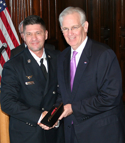 Gov. Nixon Jay Nixon presents the 2014 Medal of Valor to Daniel Roderick of the West County EMS and Fire Protection District.